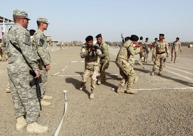 American and Iraqi trainers instruct Iraqi soldiers