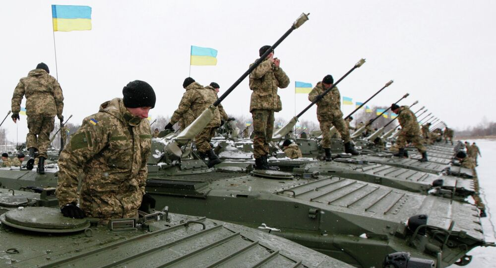 Ukrainian servicemen get inside armoured personnel carriers (APC) during a ceremony to hand over weapons, military equipment and aircraft to the army at a firing range outside Zhytomyr January 5, 2015
