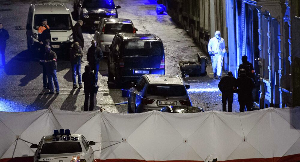 Belgian police inspect an apartment in central Verviers following an anti-terror raid which resulted in the deaths of two suspects and the capture of a third.