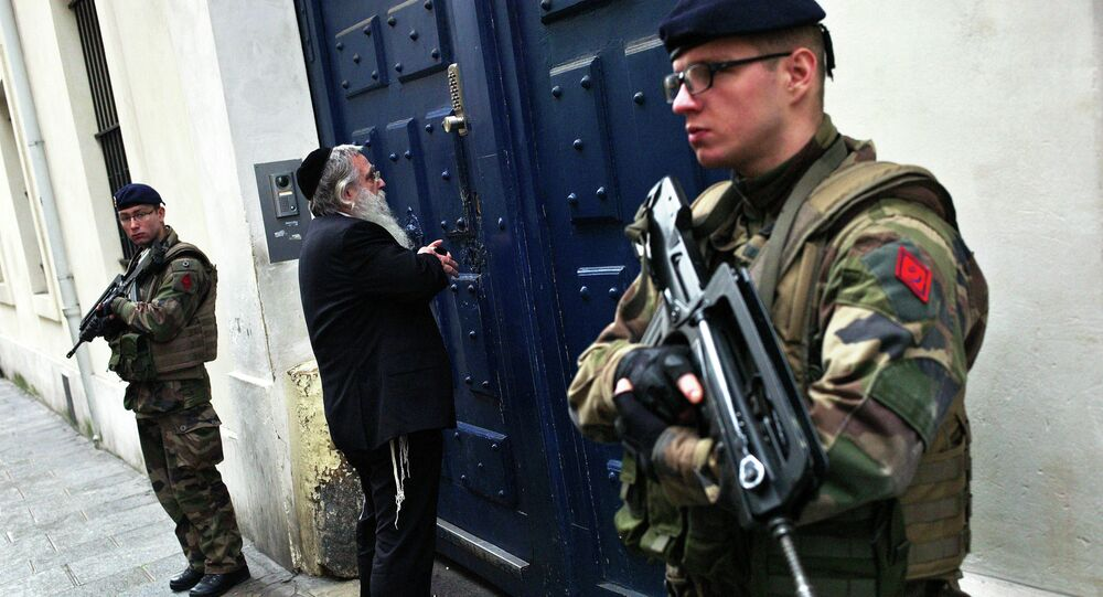 French soldiers secure the access to a Jewish school, in Paris