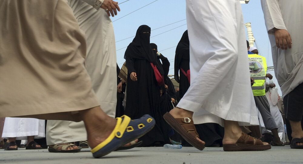 Muslim pilgrims make their way to throw stones at a pillar, symbolizing the stoning of Satan in a ritual called Jamarat, the last rite of the annual hajj, in the Mina neighborhood of Mecca, Saudi Arabia, Sunday, Oct. 5, 2014