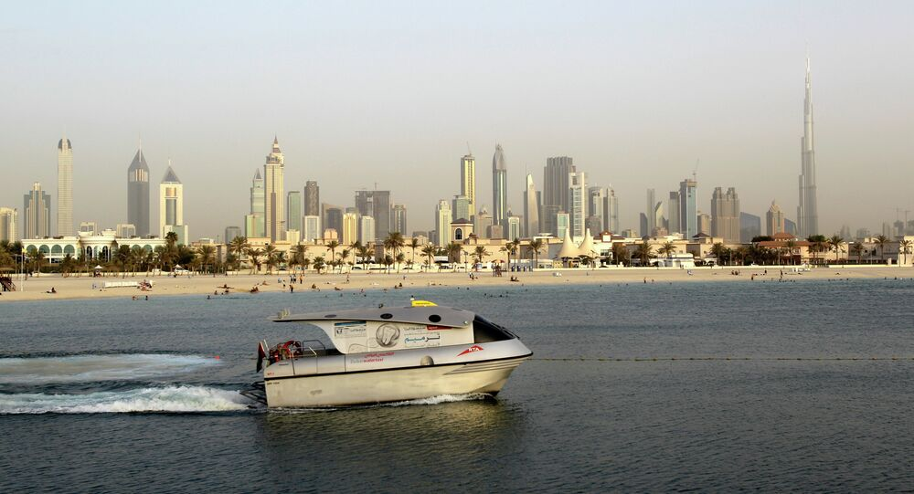 In this photo dated Thursday, July 26, 2012, a public transport boat crosses the water as people enjoy swimming at Jumeirah open beach with the city skyline in background, Dubai, United Arab Emirates. Archive photo.