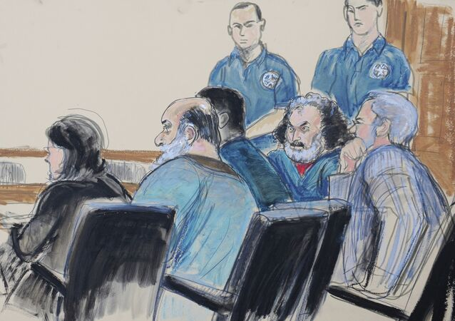 In this courtroom drawing, seated from left, defense attorney Sabrina Shroff, defendants Kahlid al-Fawwaz and Adel Abdul Bary and attorney Andrew Patel appear before a judge in Manhattan federal court in New York on Saturday, Oct. 6, 2012