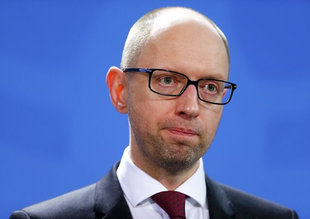 Ukrainian Prime Minister Arseny Yatseniuk addresses a news conference following talks at the Chancellery in Berlin January 8, 2015