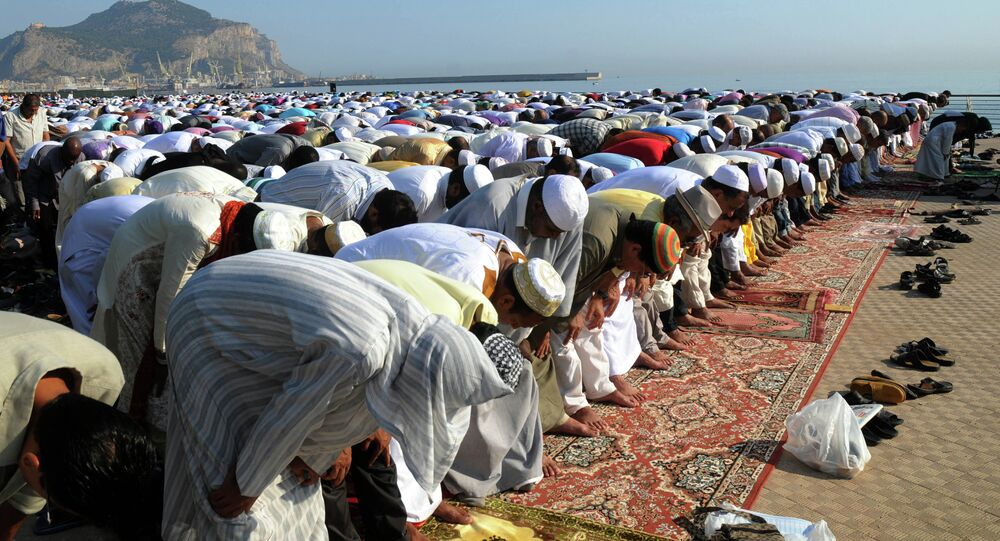 Muslims pray during Eid al-Fitr prayer, which marks the end of the holy month of Ramadan, in Palermo, Italy