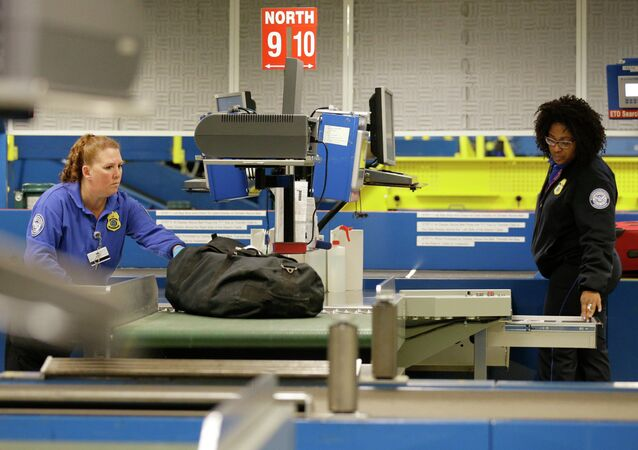 Transportation Security Administration employees check bags