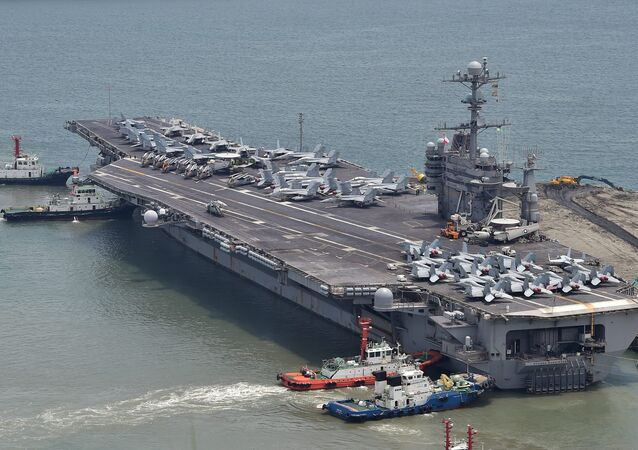 The US nuclear powered aircraft carrier USS George Washington arrives at the southeastern port city of Busan on July 11, 2014