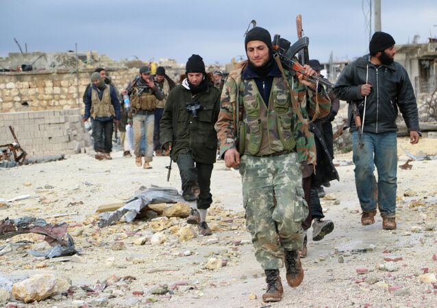Opposition fighters walk in the al-Breij area northwest on the northern Syrian city of Aleppo