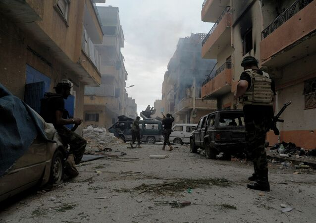 Libyan military soldiers check on an area