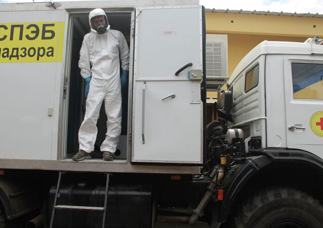 File Photo: Russian doctor Valentine Safronov stands inside a mobile medical lab donated by the Russian government to assist with the Ebola out-brake in Conakry, Guinea, Tuesday, Aug. 26, 2014.