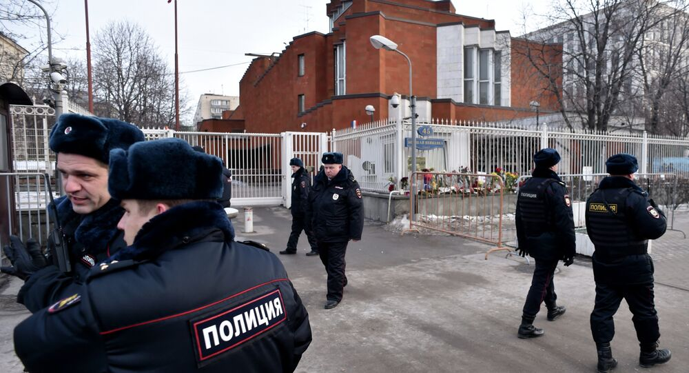 Russian police officers patrol next to the French embassy in Moscow on January 16, 2015
