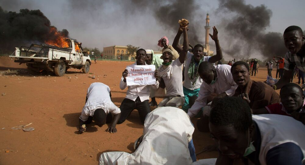 Rioters have set fire to at least seven churches in Niger's capital of Niamey on Saturday during an ongoing turmoil, sparked by Charlie Hebdo's publication of a cartoon mocking the Prophet Mohammad