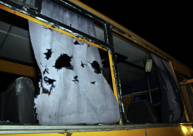 A view of the shattered windows and the torn curtains of a bus hit during shelling apparently aimed at a checkpoint manned by Ukrainian forces in Volnovakha, in the eastern Donetsk region, on January 13, 2015