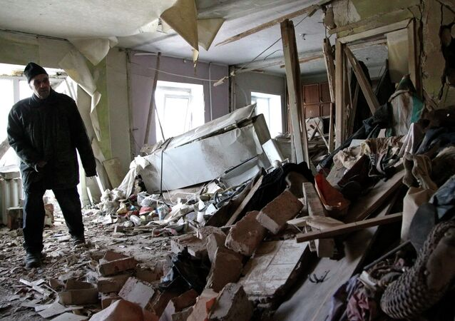 Local resident Nikolai, 82, inspects his apartment, which according to locals, was recently destroyed by shelling, in Donetsk
