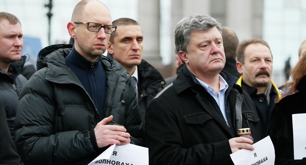 Ukrainian President Petro Poroshenko (R, front) and Prime Minister Arseny Yatseniuk (L, front) take part in a peace march in tribute to the victims onboard a passenger bus, which came under fire near the town of Volnovakha, in Kiev, January 18, 2015.