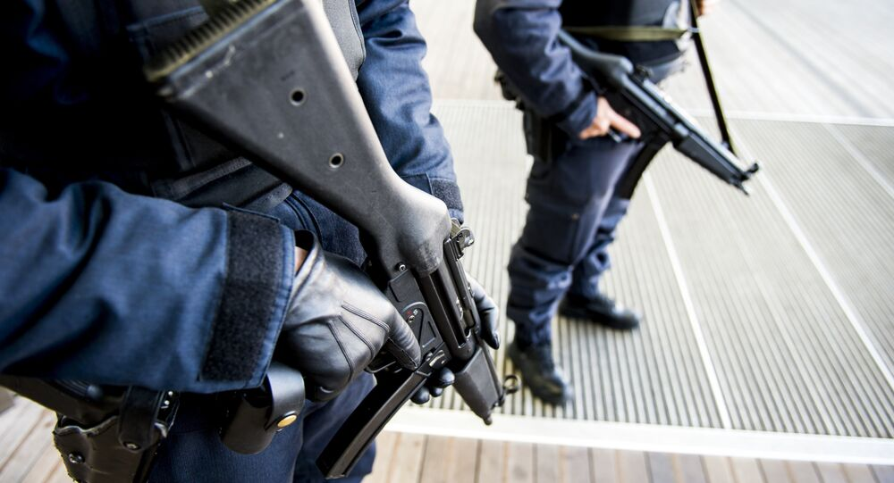 Policemen patrol near the courthouse on Bolivar Square in Antwerp