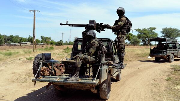 Cameroonian soldiers patrol in Amchide, northern Cameroon, 1 km from Nigeria - Sputnik International