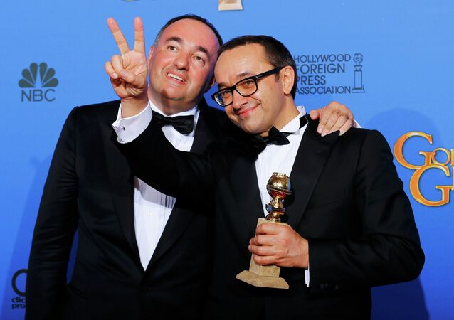 Producer Alexander Rodnyansky (L) and director Andrey Zvyagintsev pose backstage with their award for Best Foreign Language Film for their film Leviathan at the 72nd Golden Globe Awards in Beverly Hills, California