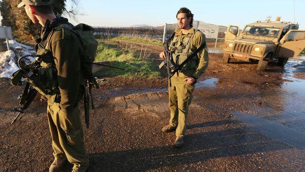 Israeli troops patrol the Israeli-occupied sector of the Golan Heights - Sputnik International