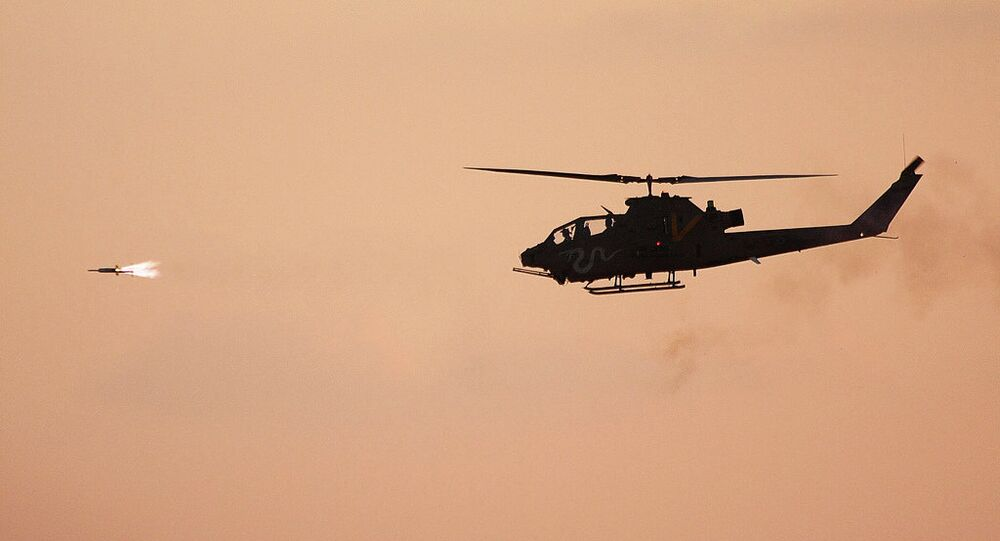 A 'Viper' attack helicopter launches a missile toward a marked target