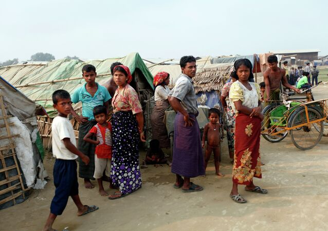 """Myanmar Muslims, who identify themselves as long-persecuted """"Rohingya"""" Muslims stand outside their tents at Da Paing camp for Muslim refugees in north of Sittwe, Rakhine State, western Myanmar"""