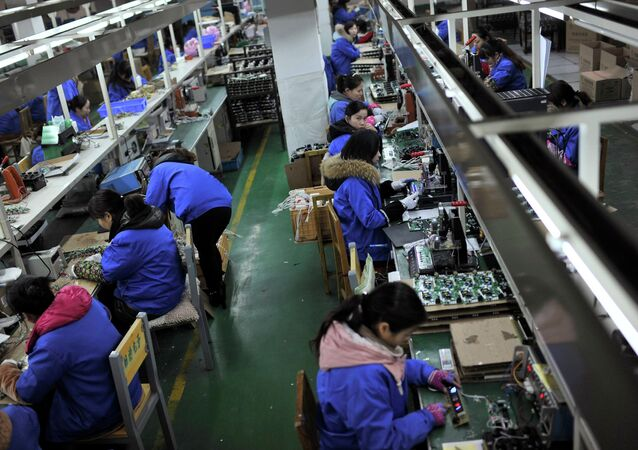 Employees assemble electronic components