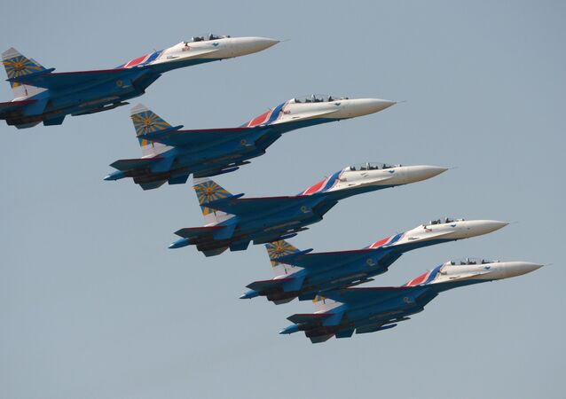 Su-27 fighter aircraft of the aerobatic display team Russkye Vityazi (Russian Knights) during the Air Force Day celebration in Lipetsk.