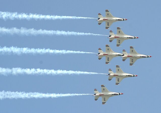 Aircraft of the 'Thunderbirds' US Air Force Air Demonstration Squadron fly as they perform during an air show at Don Muang airport in Bangkok