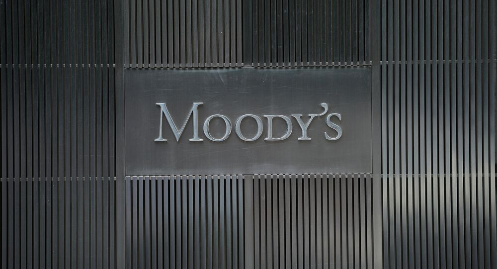 A sign for Moody's rating agency is displayed at the company headquarters in New York