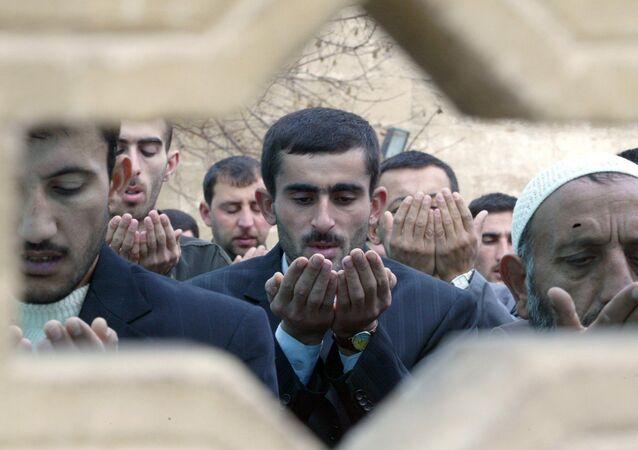 Azerbaijani muslims pray in a mosque in Baku