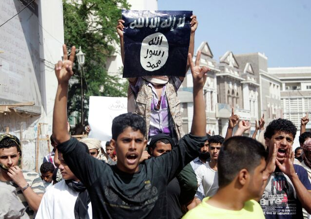 A protester holds up the flag of the Islamic State