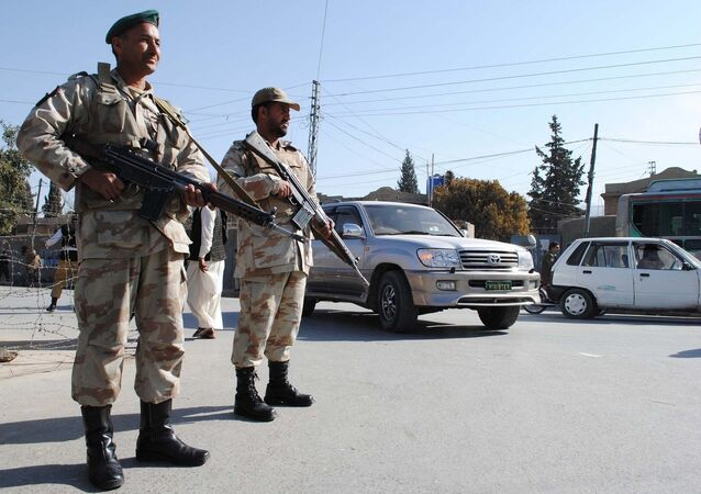 Security members stand guard on the road , Pakistan