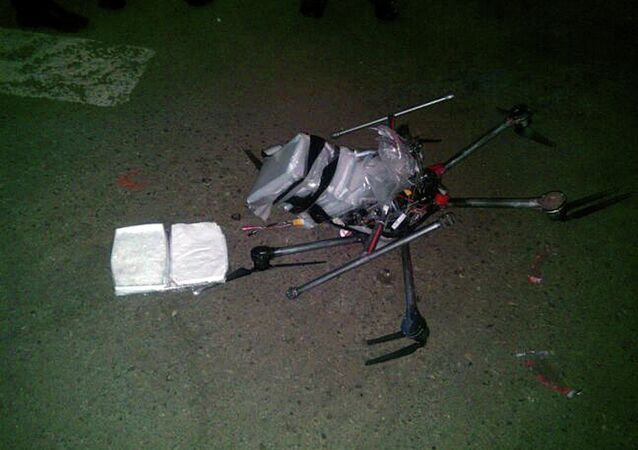 A drone loaded with packages containing methamphetamine lies on the ground after it crashed into a supermarket parking lot in the city of Tijuana on Tuesday Jan. 20, 2015