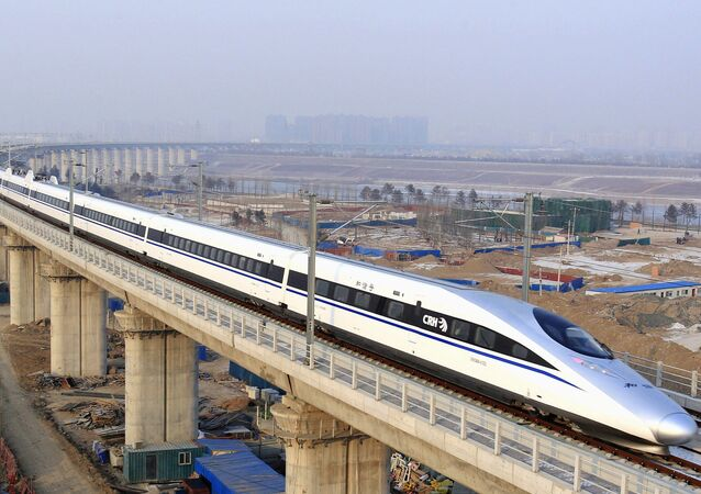In this photo released by China's Xinhua news agency, a bullet train passes over Yongdinghe Bridge in Beijing Wednesday, Dec. 26, 2012