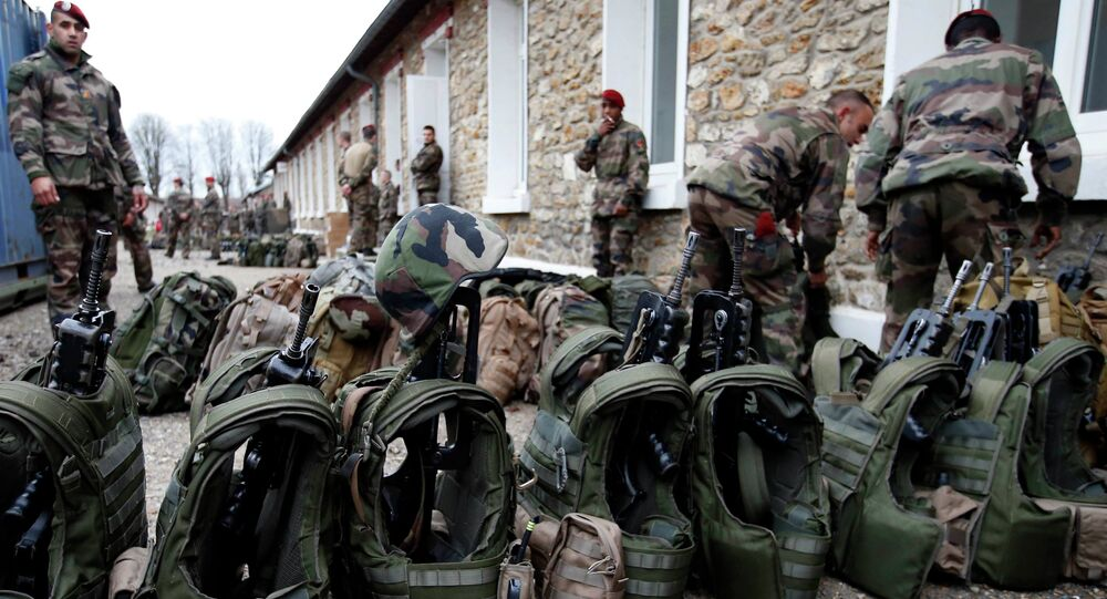 French soldiers prepare their equipment at the Satory military base, near Paris, as part of the highest level of Vigipirate security plan after last week's Islamic militants attacks January 13, 2015