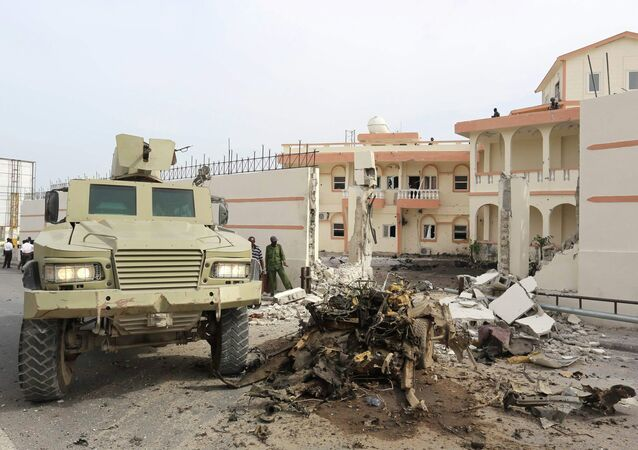 Somali government forces drive their armoured personnel carrier (APC) at the scene of a suicide car explosion in front of the SYL hotel in the capital Mogadishu January 22, 2015