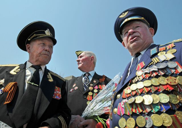 World War II veterans Albert Semushin of Moldova, left, Grigory Rekobratsky of Lithuania, center background, and Vladimir Buhenko of Moldova, meet at the World War II memorial near Volgograd, about 900 kilometers (550 miles) southeast of Moscow, Friday, May 7, 2010