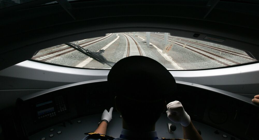 A Chinese train driver takes the new bullet train on a test run on the new high-speed Beijing-Tianjin express railway in Beijing on June 26, 2008