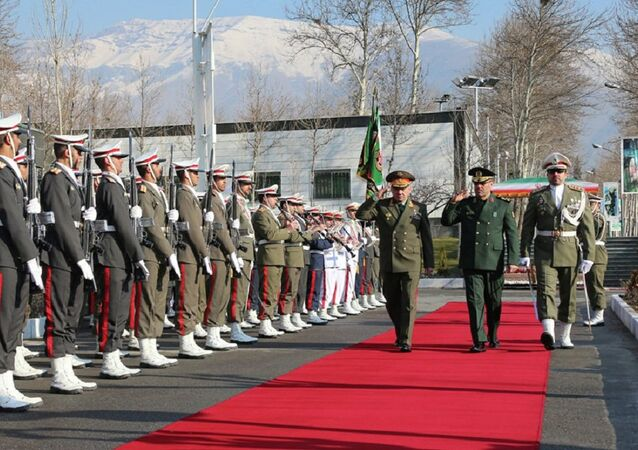 Russian Defense Minister Sergei Shoigu, third right, and Hossein Dehghan, second right, Brigadier General and Minister of Defense of Iran, meet in Tehran