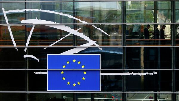 People are pictured through a window at the European Parliament in Brussels. - Sputnik International
