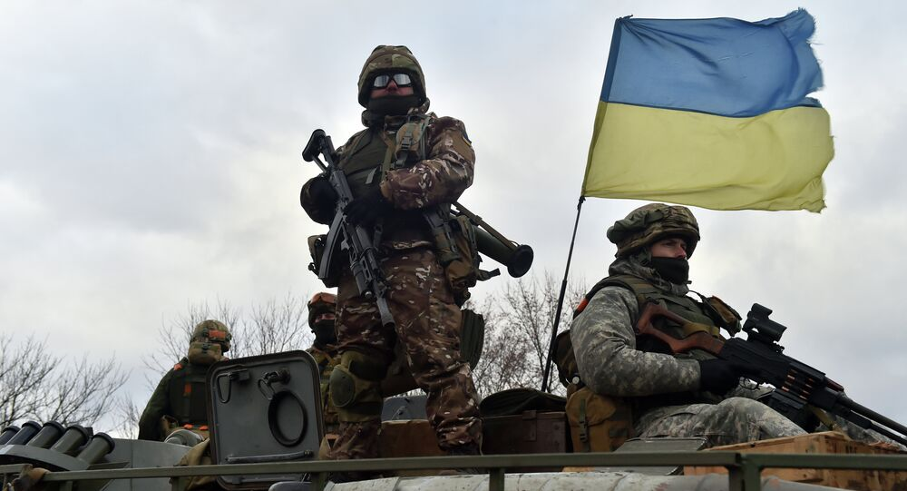 Ukrainian soldiers ride on a armored personnel vehicle outside the eastern Ukrainian city of Debaltseve