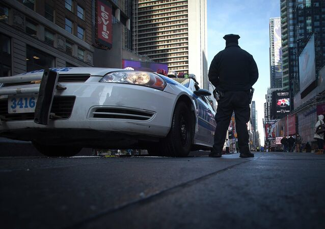 A police officer stands guard in Times Square in the Manhattan borough of New York January 15, 2015