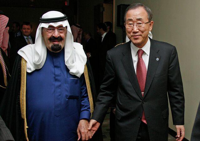 United Nations Secretary-General Ban Ki-moon (R) walks with Saudi Arabia's King Abdullah (L)