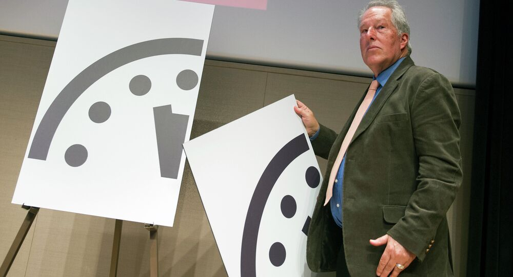 Climate scientist Richard Somerville, a member, Science and Security Board, Bulletin of the Atomic Scientists, unveils the new Doomsday Clock in Washington, Thursday, Jan. 22, 2015