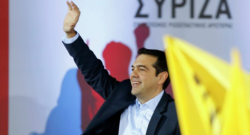 Opposition leader and head of radical leftist Syriza party, Alexis Tsipras waves at supporters during a campaign in central Athens, January 22, 2015