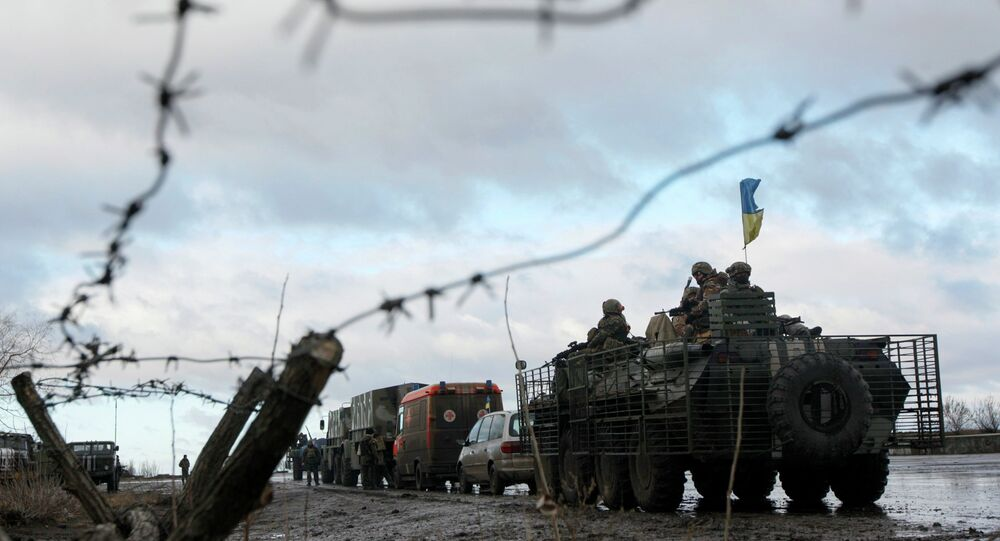 A Ukrainian military convoy is pictured through a barbed wire fence at a military base in the town of Kramatorsk, eastern Ukraine