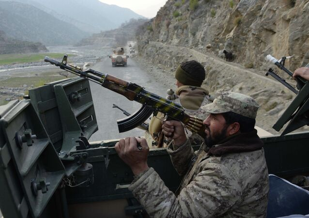 Afghan security personnel patrol during an ongoing anti-Taliban operation in Dangam district near the Pakistan-Afghanistan border in the eastern Kunar province