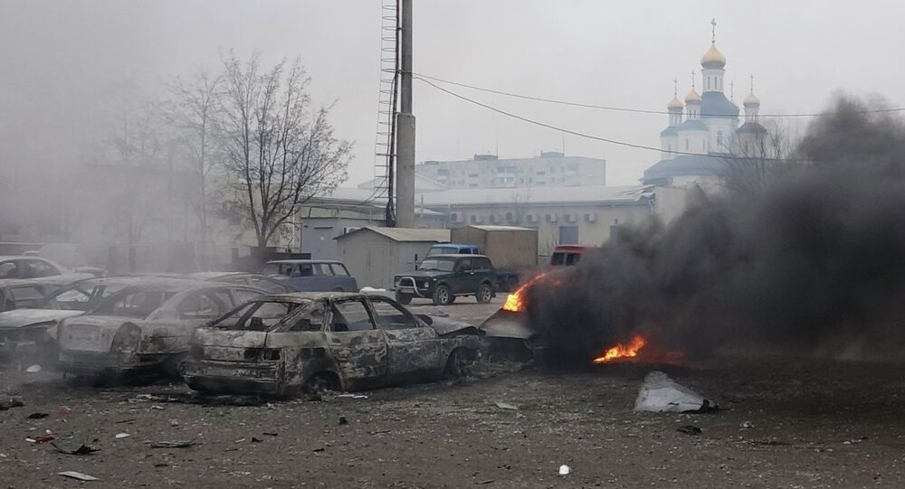 A car burns on the street after a shelling of a residential sector of Mariupol, eastern Ukraine, January 24, 2015