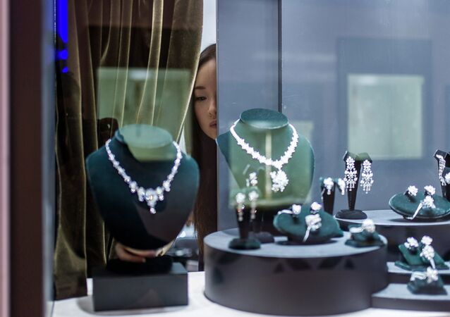 A vendor checks a display prior to the opening of the Hong Kong Jewellery and Gem fair at the convention and exhibition Centre on September 17, 2014