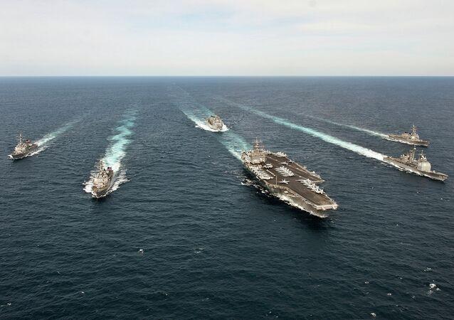 The Enterprise Carrier Strike Group transits the Atlantic Ocean